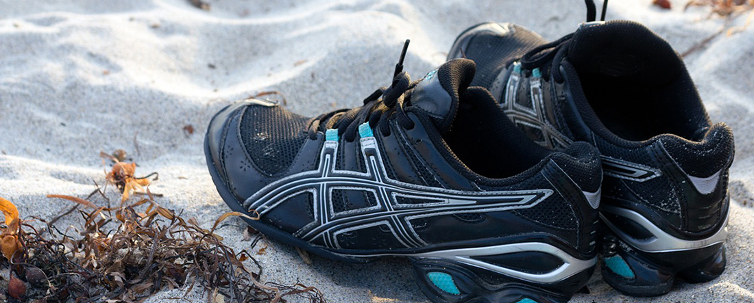 running shoes, sand and seaweed