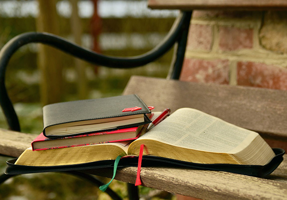 bench with bible and books