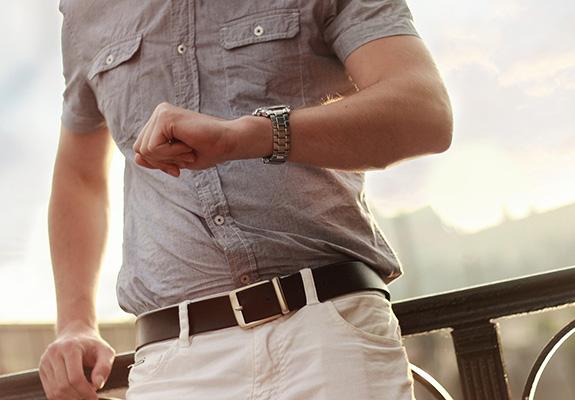 man looking at his watch